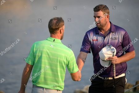 Marc Leishman, Graham DeLaet Marc Leishman, right, of Australia, shakes hands with Graham DeLaet, of Canada, after finishing on the 18th green during the second round of the Arnold Palmer Invitational golf tournament in Orlando, Fla