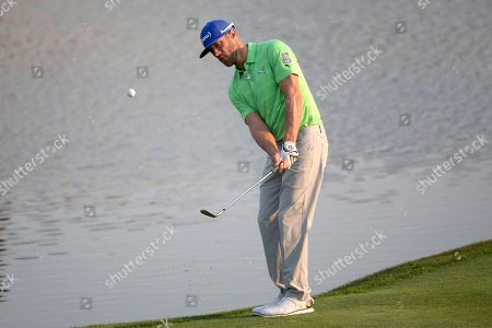 Graham DeLaet, of Canada, chips onto the 18th green during the second round of the Arnold Palmer Invitational golf tournament in Orlando, Fla