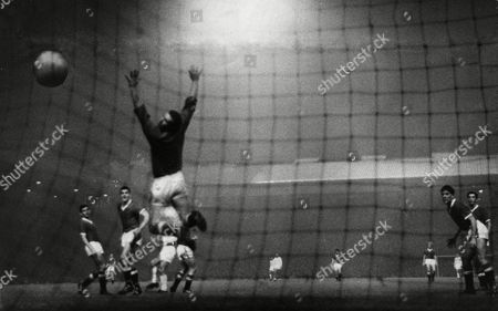 Manchester United V Real Madrid In A 1959 Friendly Match. A Leap In Vain By Harry Gregg As Francisco Gento (paco Gento) Smashes The Ball Home From A Rebound. The Spanish Team Agreed To Play Several Friendlies To Help Accelerate United's Recovery From The Ravages Of The Munich Disaster.