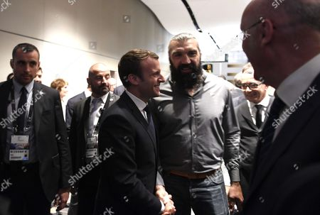 French president Emmanuel Macron (C,L) shakes hands with former French number 8 Sebastien Chabal (C,R)