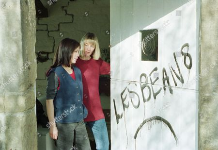Scott and Roy are busy cleaning off the graffiti - With Roy Glover, as played Nicky Evans, Scott Windsor, as played by Toby Cockerell ; Zoe Tate, as played by Leah Bracknell, and Emma Nightingale, as played by Rachel Ambler. (Ep 1970 - 4th May 1995).