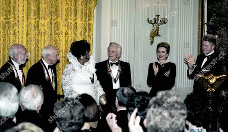 The honorees L-R Pete Seeger, Harold Prince, Morton Gould, Aretha Franklin, Kirk Douglas. Hillary and Bill Clinton.