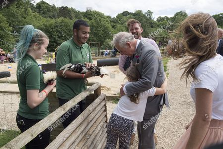 Prince Charles, Patron, The Rare Breeds Survival Trust, visited Jimmy's Farm and met the trust's new President, Jimmy Doherty, and learned about the farm's education and rare breeds programme. 8 Year Old Skye Skillen From Colchester Gives the Prince a Hug as they Look at Polish Chickens