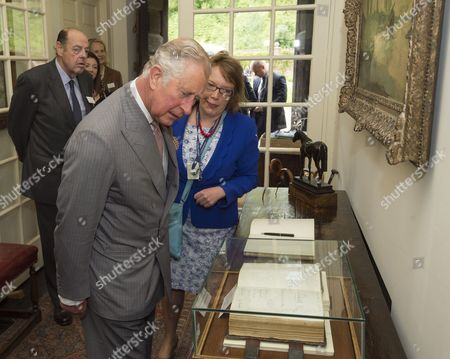Prince Charles as President of The National Trust on a visit to Chartwell House, former country home of Sir Winston Churchill, which has undergone restoration, Prince Charles looking at a signature by his grandmother in the visitors book