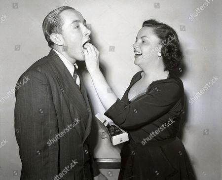 Actress Judy Garland (died June 1969) Feeds Her Fan Robert Johnstone A Chocolate In Glasgow.