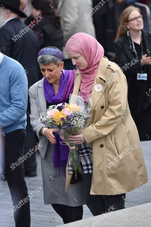 Rabbi Laura Janner-Klausner (left). A vigil is held outside City Hall to honour the victims of the London Bridge terrorist attack.