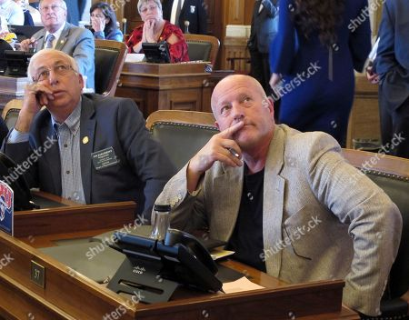 Jim Karleskint, Larry Campbell Kansas state Reps. Jim Karleskint, left, R-Tonganoxie, and Larry Campbell, right, R-Olathe, watch an electronic voting board as the House rejects a package that would boost funding on public schools and raise income taxes, at the Statehouse in Topeka, Kan. Campbell was the House's lead negotiator in talks with the Senate that produced the doomed plan
