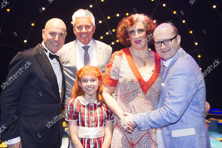 Stock Image of Alex Bourne (Daddy Warbucks), David Ian (Producer), Ruby Stokes (Annie), Miranda Hart (Miss Hannigan) and Michael Harrison (Producer) backstage