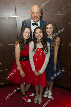 Madeleine Haynes (Annie), Alex Bourne (Daddy Warbucks), Ruby Stokes (Annie) and Lola Moxom (Annie)