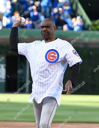 Baseball Hall of Famer Andre Dawson throws out a ceremonial first pitch before a baseball game between the Chicago Cubs and the Miami Marlins, in Chicago