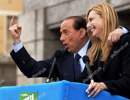 (FILES) Picture dated 29 May 2005  shows Italian center right opposition leader Silvio Berlusconi joking with 'Forza Italia' party provincial representative Michaela Biancofiore, during an electoral rally in Bolzano, Northern Italy. Berlusconi's wife Veronica Lario demanded a public apology from her husband Wednesday 31 January 2007 for sexist quips that she said were 'damaging to my dignity', in a bitter font-page letter to a leading newspaper and she has been complaining about serious flirting with another prominent Italian women.