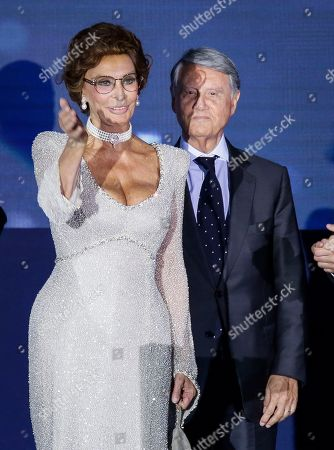 Italian actress Sofia Loren gestures during the christening ceremony of the MSC Meraviglia cruise ship with MSC Group Executive Chairman Gianluigi Aponte in Le Havre harbour, Normandy, France, . The cruise ship is the biggest built by MSC Cruises, the Swiss-based world's largest privately-owned cruise line and also the biggest ship to come into service in 2017