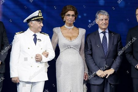 Stock Photo of Italian actress Sofia Loren poses during the christening ceremony of the MSC Meraviglia cruise ship with Master of the MSC Meraviglia cruise ship Raffaele Pontecorvo, left, and MSC Group Executive Chairman Gianluigi Aponte, right, in the Havre harbour, Normandy, France, . The cruise ship is the biggest built by MSC Cruises, the Swiss-based world's largest privately-owned cruise line and also the biggest ship to come into service in 2017
