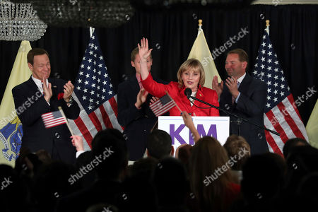 Kim Guadagno, Joe Piscopo As Joe Piscopo, actor, comedian and radio host, looks on New Jersey Republican Lt. Gov. Kim Guadagno celebrates at her primary election night event, in Long Branch, N.J