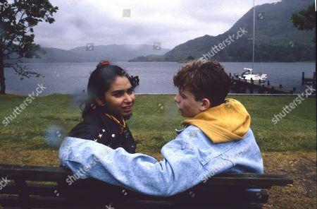 Stock Photo of Simon Gregson (as Steve McDonald) and Tania Rodrigues (as Joanne Khan)
