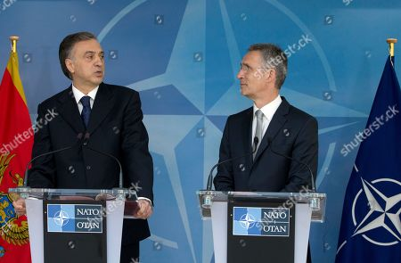 President of Montenegro Filip Vujanovic, left, and NATO Secretary General Jens Stoltenberg participate in a media conference during a ceremony to mark the accession of Montenegro at NATO Headquarters in Brussels on