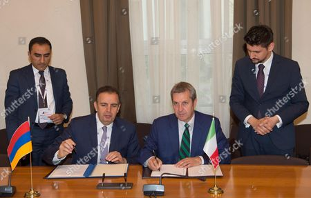 Italian Foreign Affairs Undersecretary Benedetto Della Vedova (seated R) and Armenian Deputy Foreign Minister Garen Nazarian (seated L) during the signing of the Minutes of the Joint Intergovernmental Commission Italy-Armenia at the Farnesina Palace in Rome, Italy, 07 June 2017. Others are not identified.