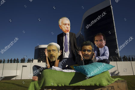 A group of people with masks of the Brazilian President Michel Temer (2-L), the Minister of the Secretary of Government Antonio Imbassahy (L), the Senator Aecio Neves (2-R) and the Minister of Foreign Affairs Aloysio Nunes (R), participates in a demonstration in front of the Supreme Electoral Court, in Brasilia, Brazil, 07 June 2017, before the start of the second hearing of the trial to decide if the 2014 presidential campaign of Dilma Rousseff and Michel Temer received illegal funds.