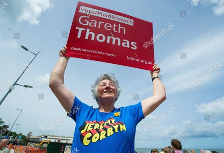 A man holding a placard in support of the local Labour Party candidate Gareth Thomas as he listens to British Labour Party leader Jeremy Corbyn (not pictured) speaking to Labour supporters during a General election campaign event on a visit to Colwyn Bay, north Wales, 07 June 2017. Voters go to the polls in the British General Election which is to be held on 08 June 2017.
