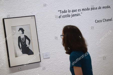 A woman looks at a picture of Coco Chanel as she visits the exhibition 'Coco Chanel and Art. Beyond Art' at the Pasion Museum in Valladolid, Spain, 07 June 2017. The exhibition will be open to public from 07 June to 27 August 2017.