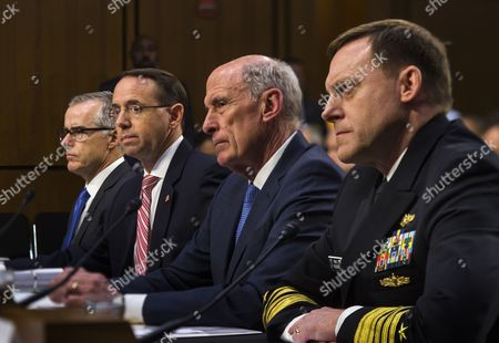 Acting FBI Director Andrew McCabe (L), Deputy Attorney General Rod Rosenstein (C-L), Director of National Intelligence Daniel Coats (C-R) and National Security Agency Director Michael Rogers (R) testify before a Senate Intelligence Committee hearing on the 'Foreign Intelligence Surveillance Act' in the Hart Senate office Building in Washington, DC, USA, 07 June 2017. Former FBI Director James Comey is scheduled to testify before the same committee on June 08.
