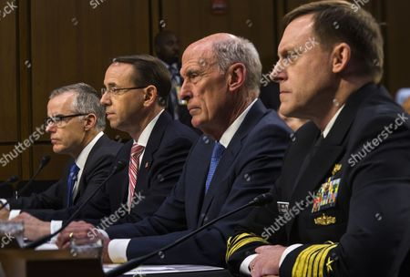Acting FBI Director Andrew McCabe (L), Deputy Attorney General Rod Rosenstein (C-L), Director of National Intelligence Daniel Coats (C-R) and National Security Agency Director Michael Rogers (R) testify.