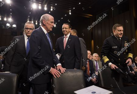 Acting FBI Director Andrew McCabe (L), Director of National Intelligence Daniel Coats (C-L), Deputy Attorney General Rod Rosenstein (C-R), and National Security Agency Director Michael Rogers (R) prepare to testify before a Senate Intelligence Committee hearing on the 'Foreign Intelligence Surveillance Act' in the Hart Senate office Building in Washington, DC, USA, 07 June 2017. Former FBI Director James Comey is scheduled to testify before the same committee on June 08.