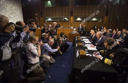 Acting FBI Director Andrew McCabe (L), Deputy Attorney General Rod Rosenstein (C-L), Director of National Intelligence Daniel Coats (C-R) and National Security Agency Director Michael Rogers (R) prepare to testify.