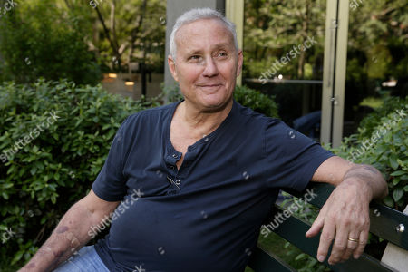 Hotelier Ian Schrager poses for photos in the Chrystie Park garden of his new PUBLIC hotel, in New York, . The new hotel opening Wednesday, June 7, 2017, on Manhattan's Lower East Side is the latest project from Schrager, who's known for introducing the concept of boutique hotels and as co-founder of the legendary disco Studio 54