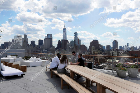 The New York skyline is visible from the outdoor section of the Roof bar of the PUBLIC hotel, in New York. The new hotel on Manhattan's Lower East Side is the latest project from Ian Schrager, who's known for introducing the concept of boutique hotels and as co-founder of the legendary disco Studio 54
