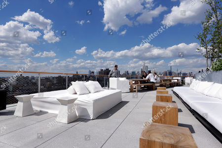 The New York skyline is visible from the outdoor section of the Roof bar of the PUBLIC hotel, in New York. The new hotel on Manhattan's Lower East Side opens Wednesday, June 7. It is the latest project from Ian Schrager, who's known for introducing the concept of boutique hotels and as co-founder of the legendary disco Studio 54