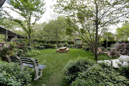 This photo shows the Chrystie Park garden at the PUBLIC hotel, in New York. The new hotel on Manhattan's Lower East Side opens Wednesday, June 7. It is the latest project from Ian Schrager, who's known for introducing the concept of boutique hotels and as co-founder of the legendary disco Studio 54