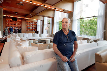 This photo shows hotelier Ian Schrager in a lounge area at his new PUBLIC hotel, in New York. The new hotel on Manhattan's Lower East Side opens Wednesday, June 7. It is the latest project from Ian Schrager, who's known for introducing the concept of boutique hotels and as co-founder of the legendary disco Studio 54