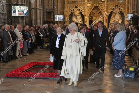 Anne Hart leads the family through the Nave of the Abbey at the end of the Service.