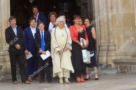 Anne Hart leads the family to the Great West Door at Westminster Abbey to wave to the crowds.