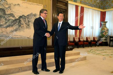 Stock Photo of Rick Perry, Zhang Gaoli U.S. Energy Secretary Rick Perry, left, shakes hands with Chinese Vice Premier Zhang Gaoli during a meeting at the Zhongnanhai leaders compound in Beijing