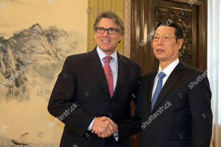 Stock Photo of Rick Perry, Zhang Gaoli U.S. Energy Secretary Rick Perry, left, poses with Chinese Vice Premier Zhang Gaoli for a photo during a meeting at the Zhongnanhai leaders compound in Beijing