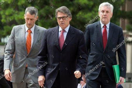 Stock Image of U.S. Energy Secretary Rick Perry, center, arrives for a meeting with Chinese Vice Premier Zhang Gaoli at the Zhongnanhai leaders compound in Beijing