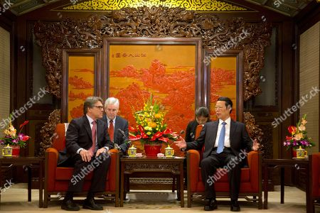 Stock Image of Rick Perry, Zhang Gaoli U.S. Energy Secretary Rick Perry, left, listens to Chinese Vice Premier Zhang Gaoli during a meeting at the Zhongnanhai leaders compound in Beijing