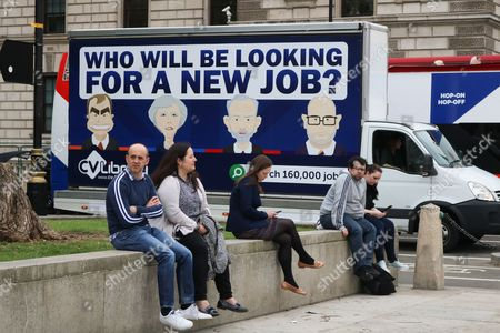 An advertising van outside Parliament showing caricatures of Tim Farron, Theresa May, Jeremy Corbyn and Paul Nuttall with the message who will be looking for a new job as Britain goes to the polls to elect a new government