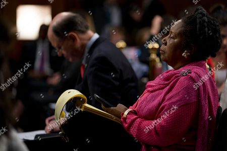 James Comey, Brad Sherman, Sheila Jackson Lee Senator Brad Sherman, D-Calif., left, and Rep. Sheila Jackson Lee, D-Texas, right, listen to Former FBI Director James Comey testify during a Senate Intelligence Committee hearing on Capitol Hill, in Washington