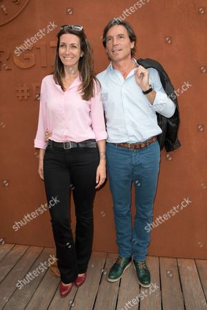 Journalist Anne-Claire Coudray and her companion Nicolas Vix arrive at the Village of Roland Garros