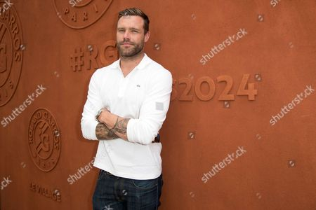 Model Nick Youngquest arrives at the Village of Roland Garros