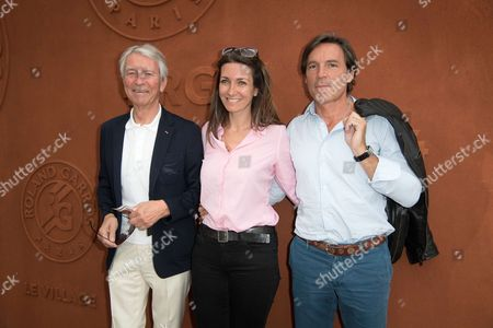Journalists Jean-Claude Narcy, Anne-Claire Coudray and her companion Nicolas Vix arrive at the Village of Roland Garros