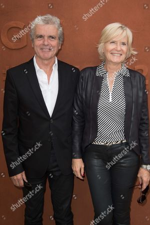 Journalist Claude Serillon and his wife Catherine Ceylac arrive at the Village of Roland Garros