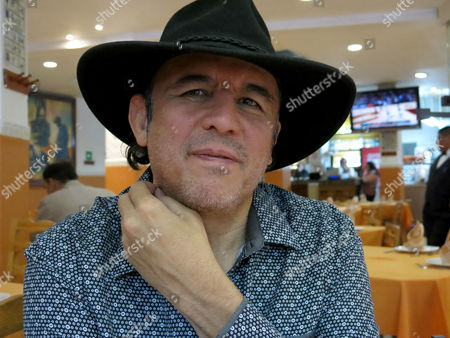 """Stock Photo of Mexican author Guillermo Fadanelli poses at a bar in Mexico City. Fadanelli's latest novel """"Al final del periferico"""" portrays his teen years in a faraway neighborhood surrounded by fields and cows in 1970's Mexico City. Fadanelli is not shy to show his failures as well of those of his friends, as well as their adventures"""