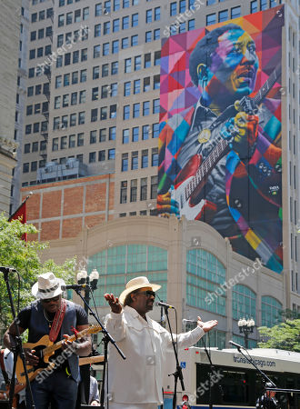 Stock Image of Big Bill Morganfield, left, and Mud Morganfield, right, perform for the dedication of the mural of their father blues music legend Muddy Waters, in Chicago. The mural was created by Brazilian street artist, Eduardo Kobra and dedicated before the city's annual blues festival this weekend