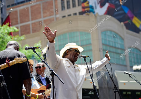 Mud Morganfield performs for the dedication of the mural of his father, blues legend Muddy Waters, in Chicago. The mural was created by Brazilian street artist, Eduardo Kobra and dedicated before the city's annual blues festival this weekend