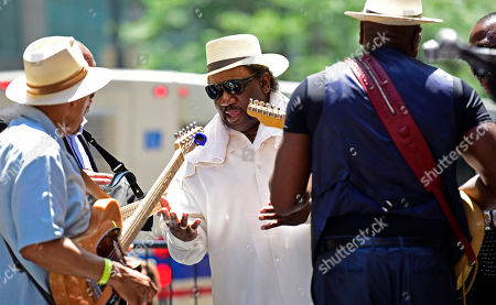Stock Photo of Mud Morganfield, son of Muddy Waters and former band members, perform for the dedication of the mural of the blues music legend Muddy Waters, in Chicago. The mural was created by Brazilian street artist, Eduardo Kobra and dedicated before the city's annual blues festival this weekend