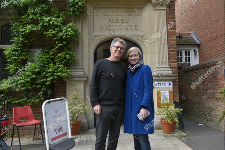 Stock Image of Nicola Blackwood, Conservative MP for Oxford West and Abingdon marginal seat, and her husband Paul Bate pose for a portrait outside the polling station in Oxford West and Abingdon